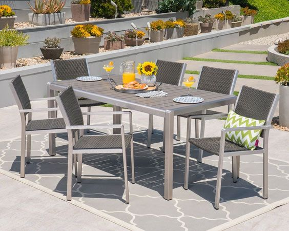Coral Bay Outdoor 7 Piece Aluminum and Wicker Dining Set with Faux Wood Table Top